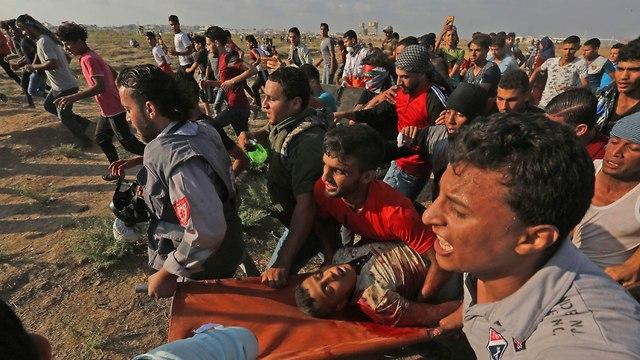 הרוג פלסטיני מאש עזב (צילום: AFP)