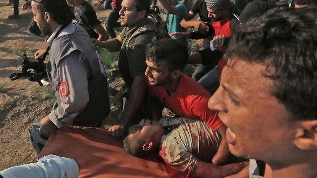 הרוג פלסטיני מאש עזה (צילום: AFP)