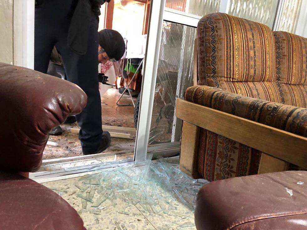 Damage caused to Sderot home hit by rocket (Photo: Israel Police)