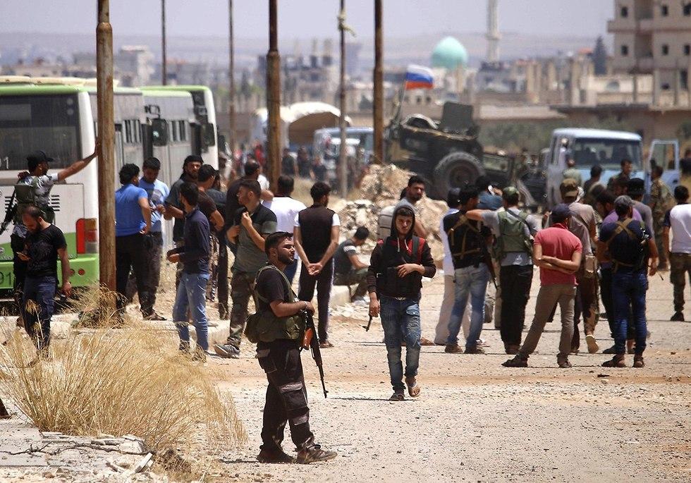 Rebels evacuate Daraa region (Photo: AFP)
