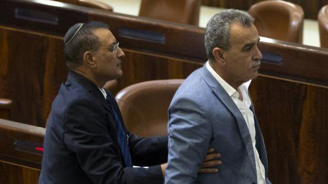 Zahalka removed from the Knesset after protesting Nationality Law (Photo: Amit Shabi)