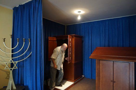 Jasa Alfandari in a makeshift synagogue in Montenegro. (Photo: Felice Friedson/The Media Line)