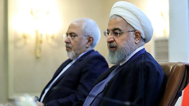 Iran's President Rouhani, right, and Foreign Minister Zarif (Photo: AFP)