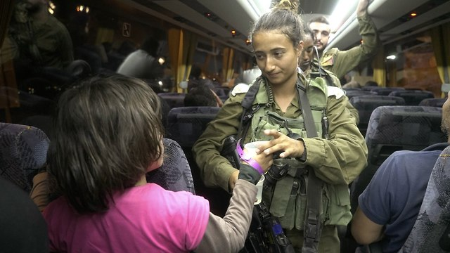 IDF troops take Syrian civilians out of war-torn south (Photo: IDF Spokesperson's Unit)