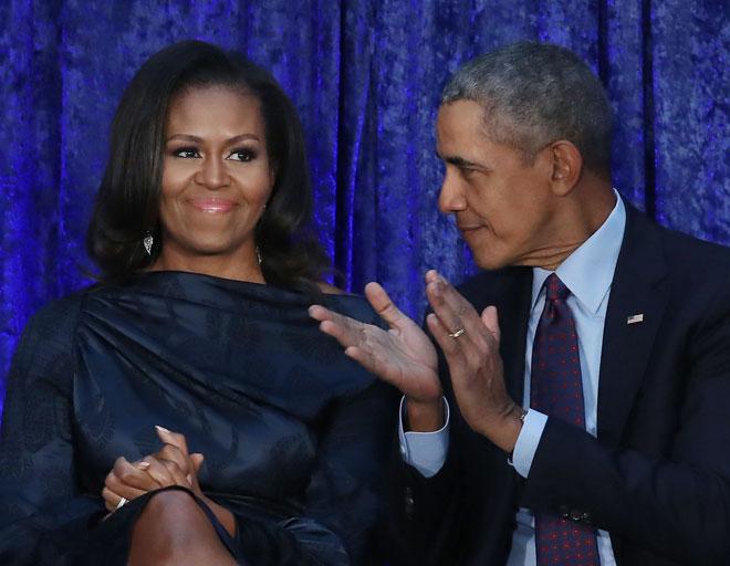 """ברק ומישל אובמה. """"אם אין לכם הרבה כסף, תזכרו שגם בעלי ואני התחלנו עם מעט מאוד"""" (צילום: Mark Wilson/GettyimagesIL)"""