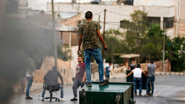 Clashes in Kobar (Photo: AFP)