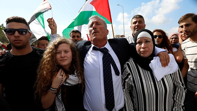 L-R: Ahed, Bassem and Nariman Tamimi (Photo: Reuters)