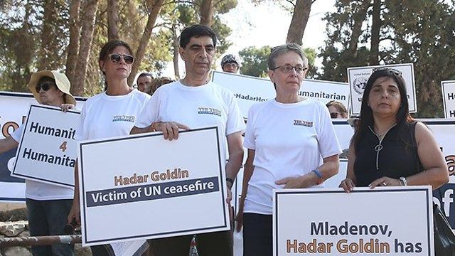 Goldin's family protests outside UN building in Jerusalem
