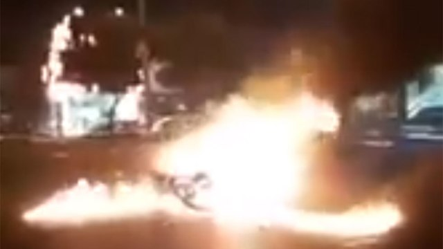 A car burning in Gohardasht