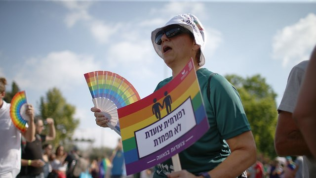 Marcher with sign saying: 'Reform woman marching unafraid' (Photo: Ohad Zwigenberg)
