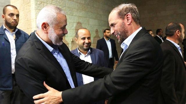 Hamas leader Ismail Hanieyh with Hamas official Husam Badran (Photo: EPA)