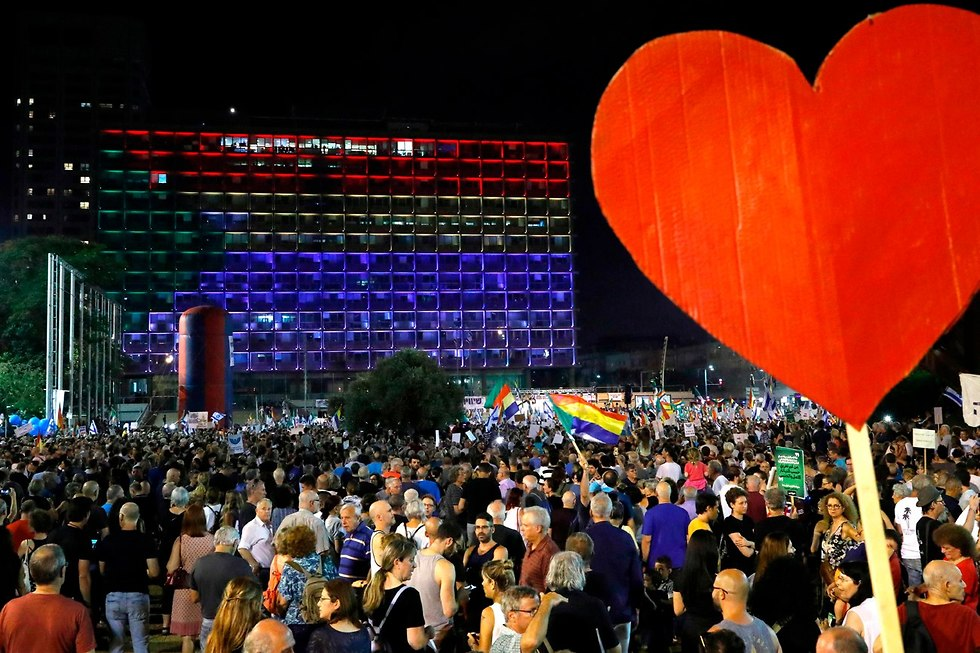 הפגנה נגד חוק הלאום בכיכר רבין (צילום: AFP)