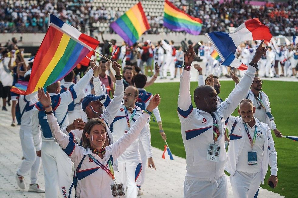 חברי הנבחרת הצרפתית בטקס הפתיחה של המשחקים הגאים (צילום: AFP)