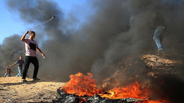 הפגנות אלימות בעזה (צילום: AFP)