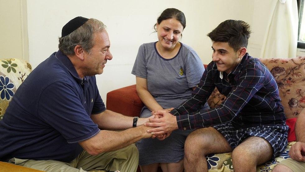 Rabbi Eckstein visiting a refugee family in Amman (Photo: IFCJ)