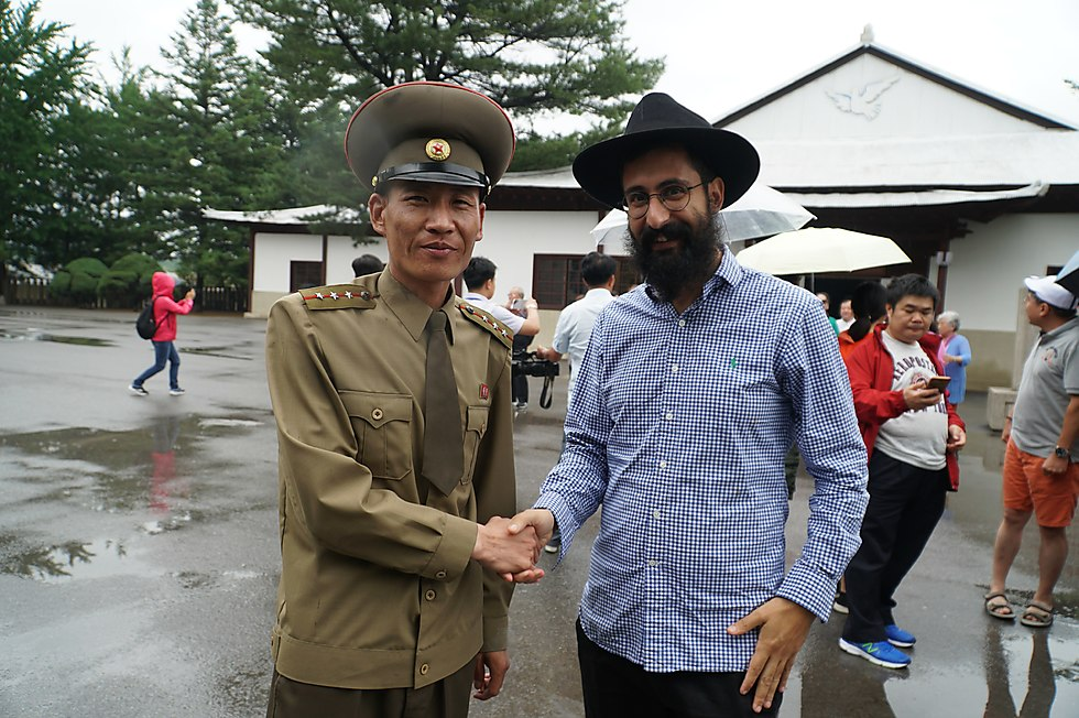 Meir Alfasi shaking hands with the local authorities in North Korea (Photo: Meir Alfasi)