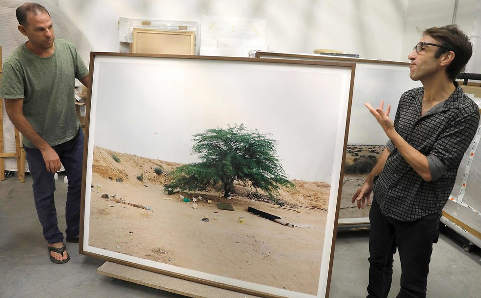 Photographer Ron Amir, left, and exhibition curator Noam Gal (Photo: AFP)