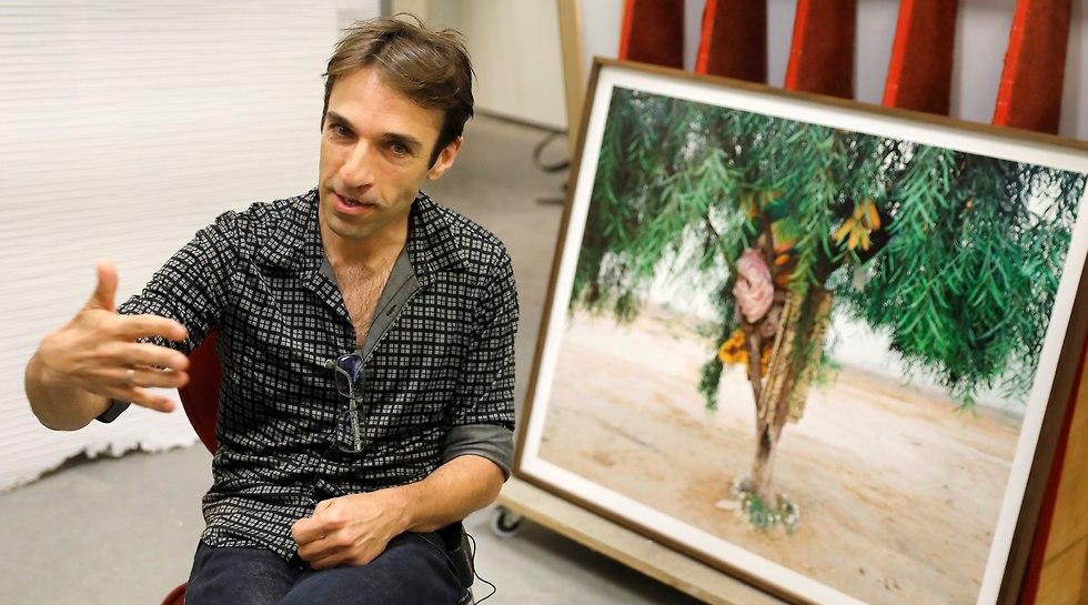 Exhibition curator Noam Gal (Photo: AFP)