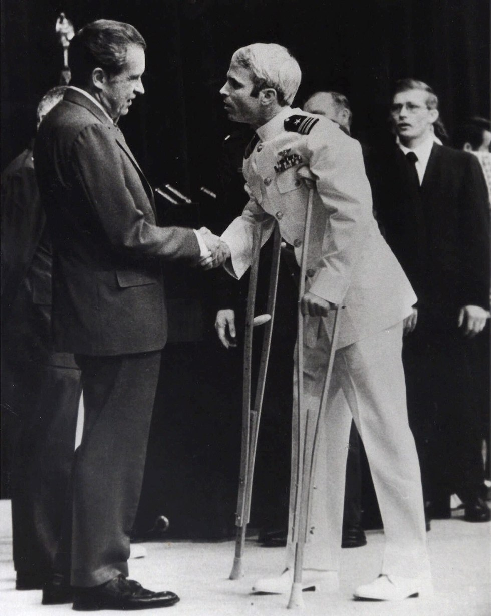 McCain shakes hands with President Richard Nixon after being released from captivity (Photo: AP)