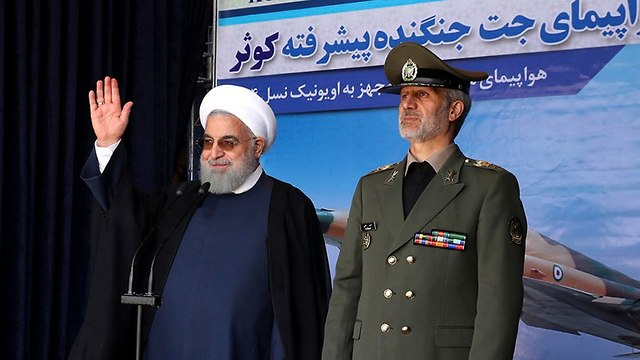 Rouhani with Defense Minister Amir Hatami (Photo: EPA)