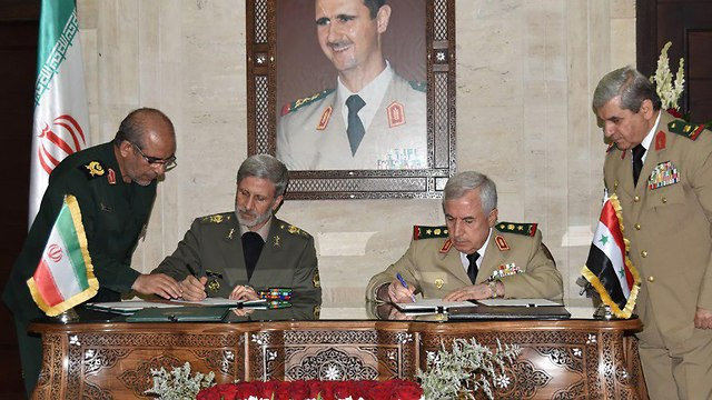 Iranian Defense Minister Amir Khatami with Syrian officials (Photo: AFP)