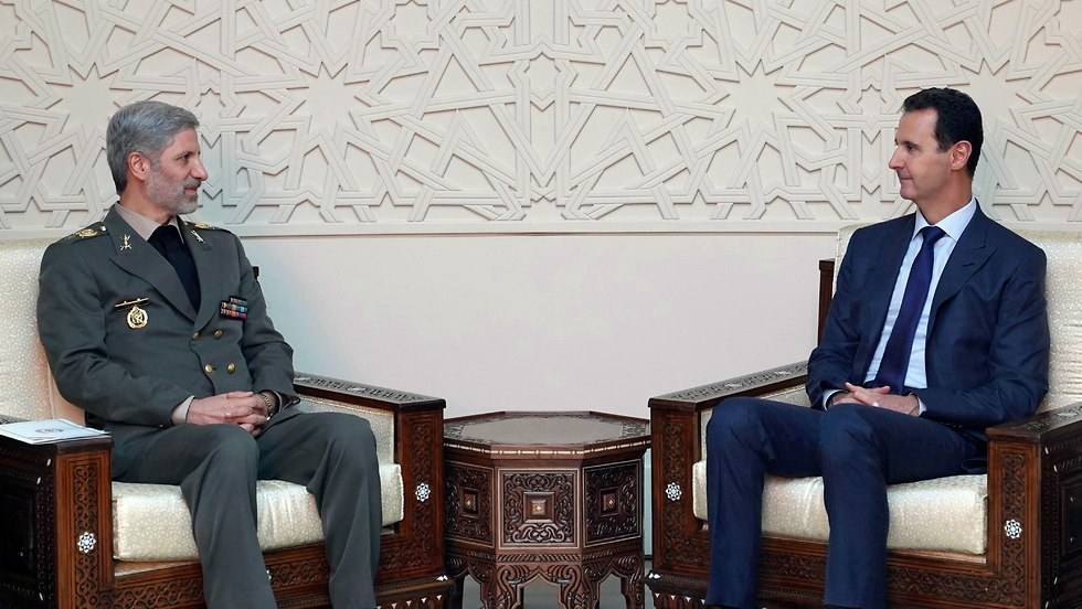Assad meeting Iranian official (Photo: AP)