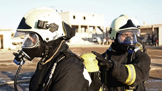 Members of the White Helmets wearing gas masks in Syria (Photo: AFP)