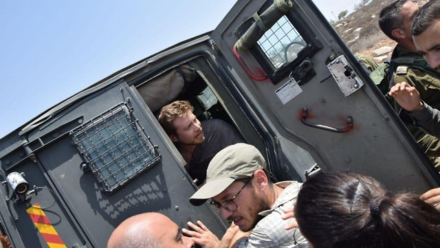 Breaking the Silence CEO Avner Gvaryahu detained by Border Police  (Photo: Breaking the Silence NGO)