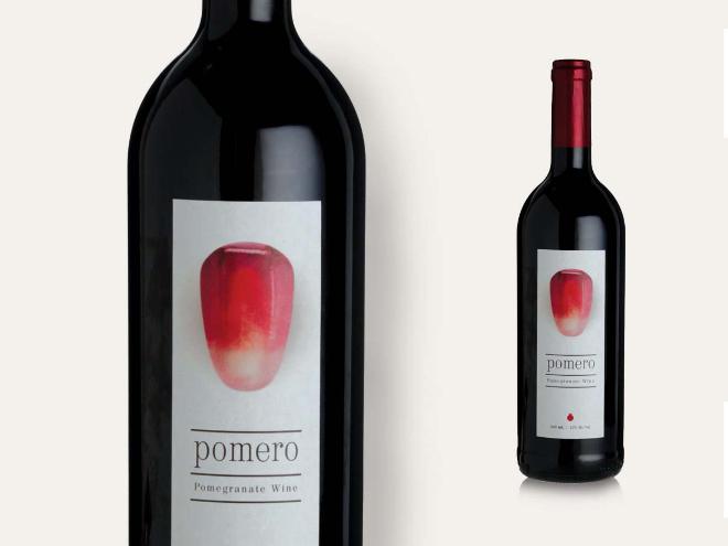 יין הרימונים ''פומרו'' עם צילום יפהפה של גרעין הפרי