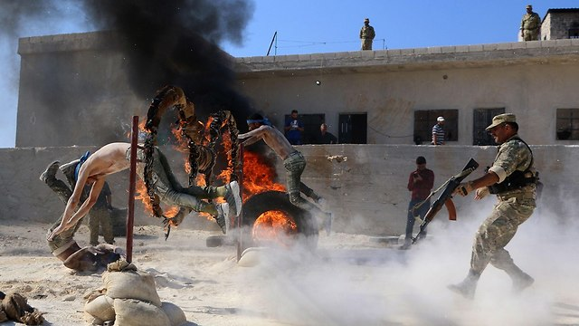 Rebel groups hold military drill (Photo: AFP)