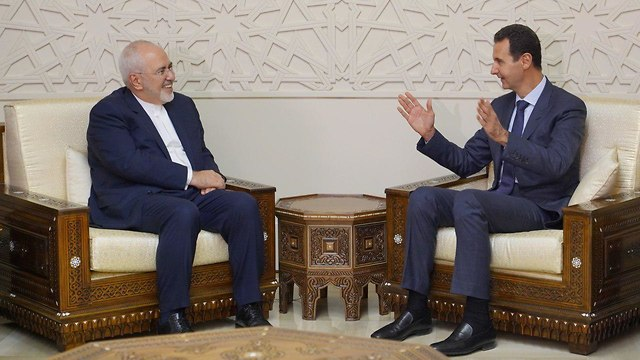 President of Syria Bashar Hafez al-Assad and Iranian Foreign Minister Mohammad Javad Zarif