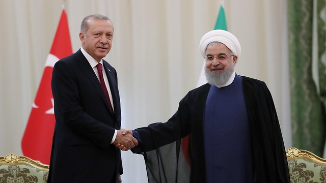 Erdogan (L) and Rouhani (Photo: Reuters)