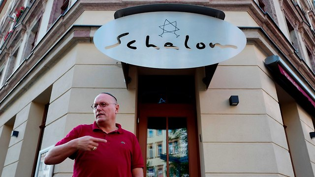 The owner, Uwe Dziuballa, standing in front of his restaurant (Photo: AFP)
