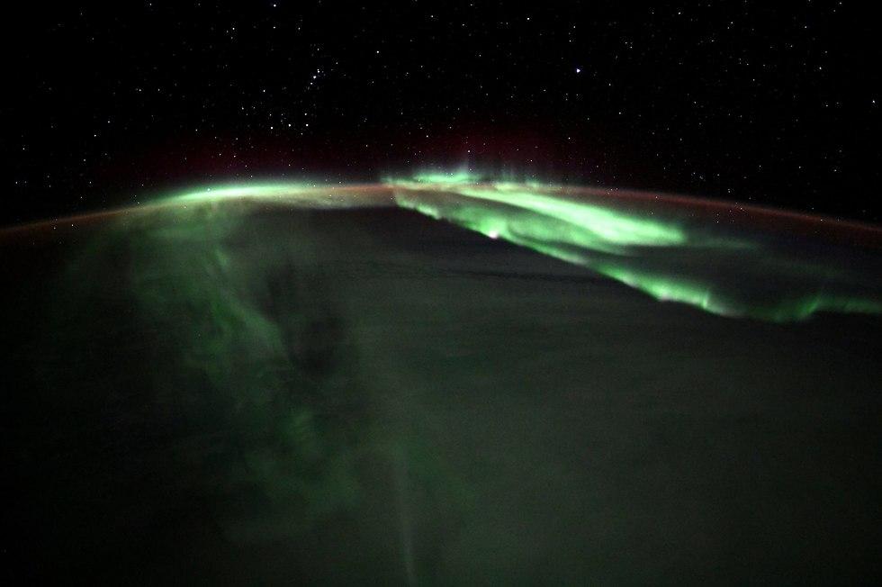 הזוהר הצפוני כפי שתועד מתחנת החלל הבינלאומית (צילום: ריצ'רד ארנולד, נאס