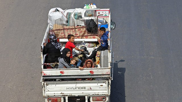 Refugees fleeing to Turkey  (Photo: AFP)