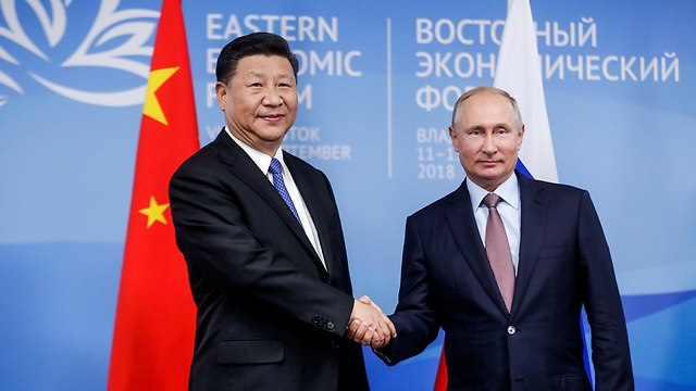 China's President Xi Jinping (L) and Russia's Putin (Photo: Reuters)