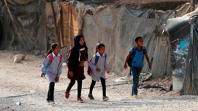Local school children (Photo: AFP)