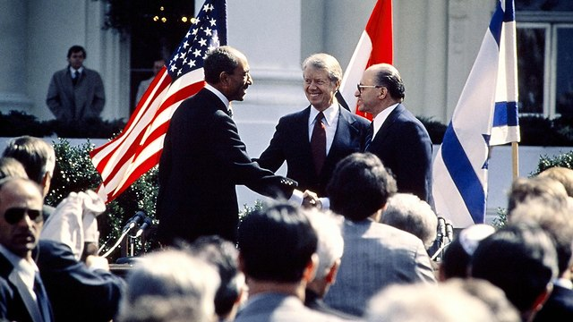 Sadat and Begin at the Carter White House (Photo: AFP)