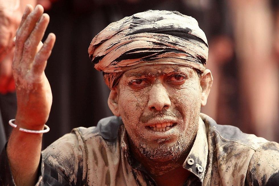יום ה עשוראא מוסלמים שיעים כרבלא עיראק (צילום: AFP)