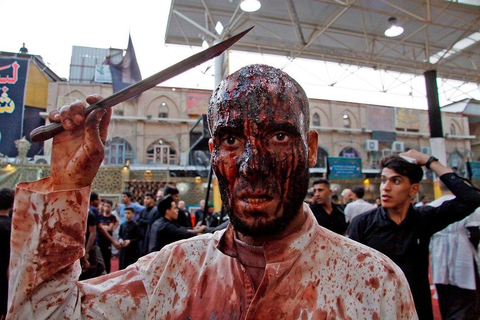 יום ה עשוראא מוסלמים שיעים נג'ף עיראק (צילום: AFP)