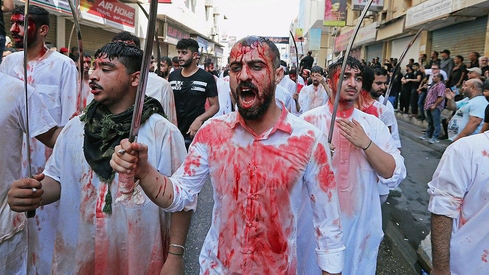 יום ה עשוראא מוסלמים שיעים מנאמה בחריין (צילום: רויטרס)