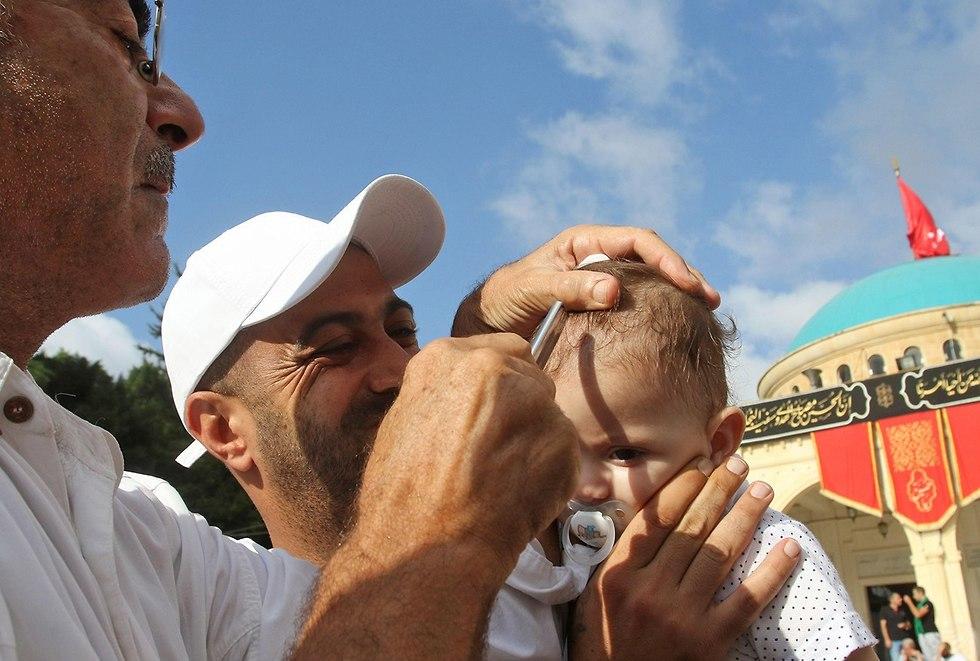 יום ה עשוראא מוסלמים שיעים א-נבטיה לבנון (צילום: AFP)