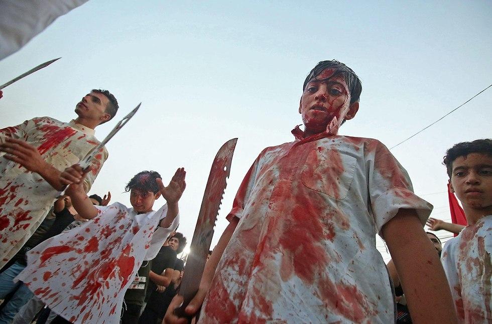 יום ה עשוראא מוסלמים שיעים בצרה עיראק (צילום: AFP)