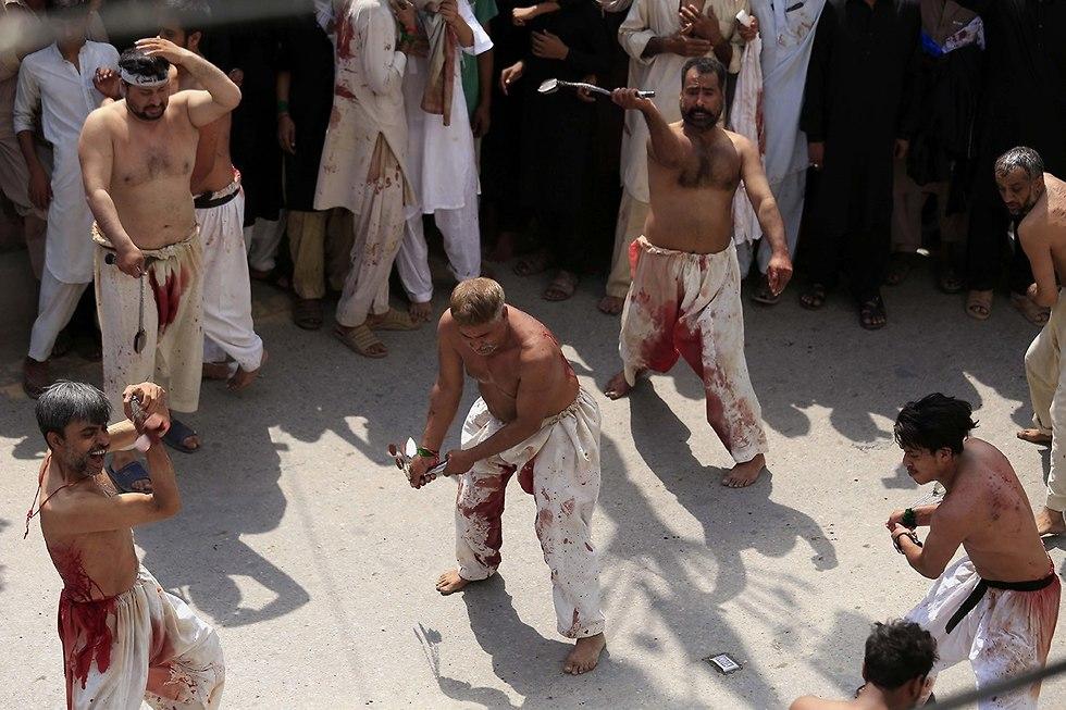 יום ה עשוראא מוסלמים שיעים פשוואר פקיסטן (צילום: EPA)