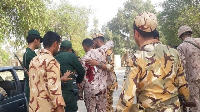 Wounded Iranian soldiers leaving scene of attack