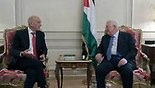 Former prime minister Ehud Olmert (L) and PA President Mahmoud Abbas