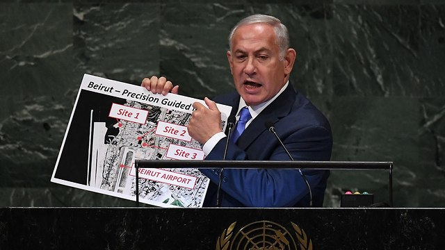 Netanyahu shows satellite images of precision missiles facility (Photo: AFP)