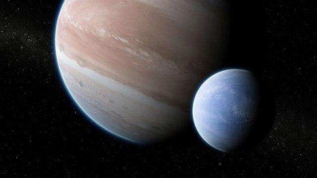 הדמיה של כוכב הלכת והירח שלו (איור: Dan Durda)