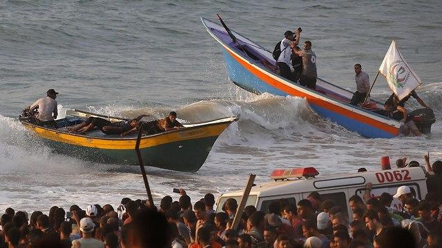 התפרעויות פלסטינים חוף ים רצועת עזה (צילום: AFP)