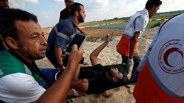 התפרעויות פלסטינים חוף ים רצועת עזה (צילום: רויטרס)